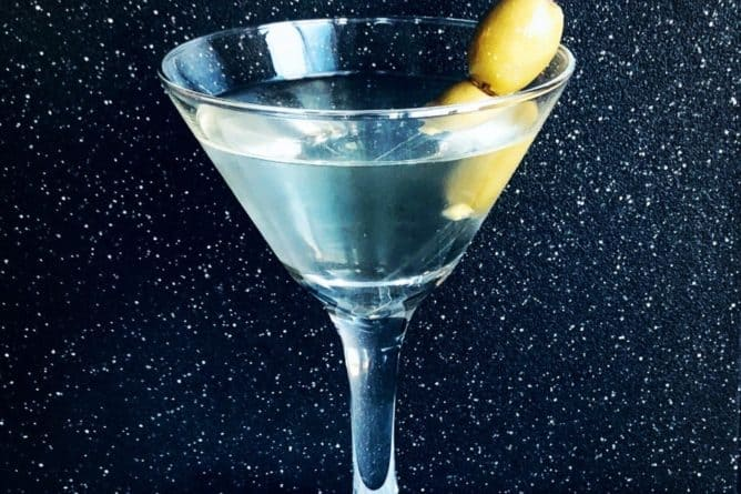 A Dirty Martini should be served in a martini glass with olives as a garnish.