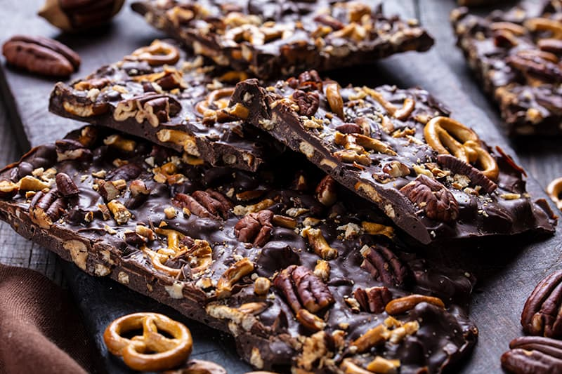 close up Turtle Chocolate Bark with crushed pretzels and pecans