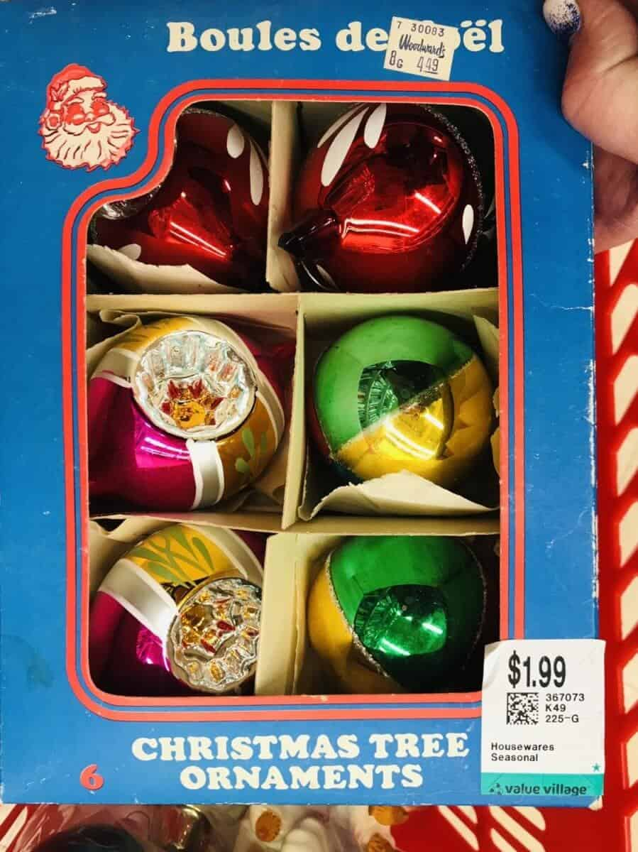 a box of Christmas tree ornaments
