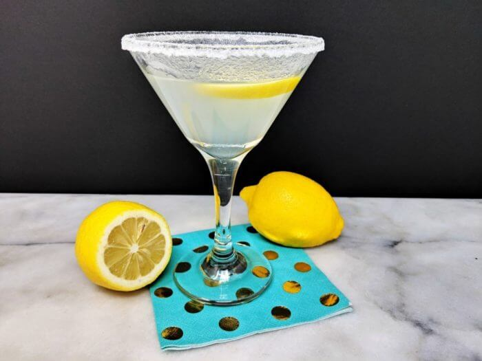 Lemon Drop Martini in a martini glass rimmed with sugar and garnish with a lemon slice