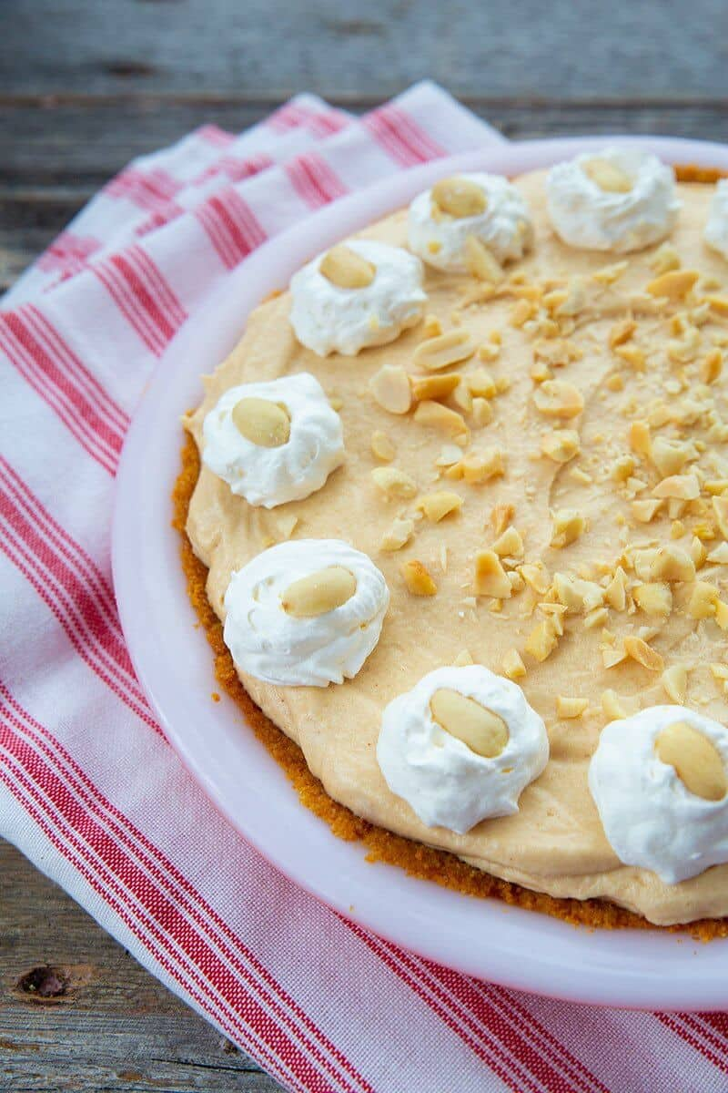 whole peanut butter pie in a white pie plate