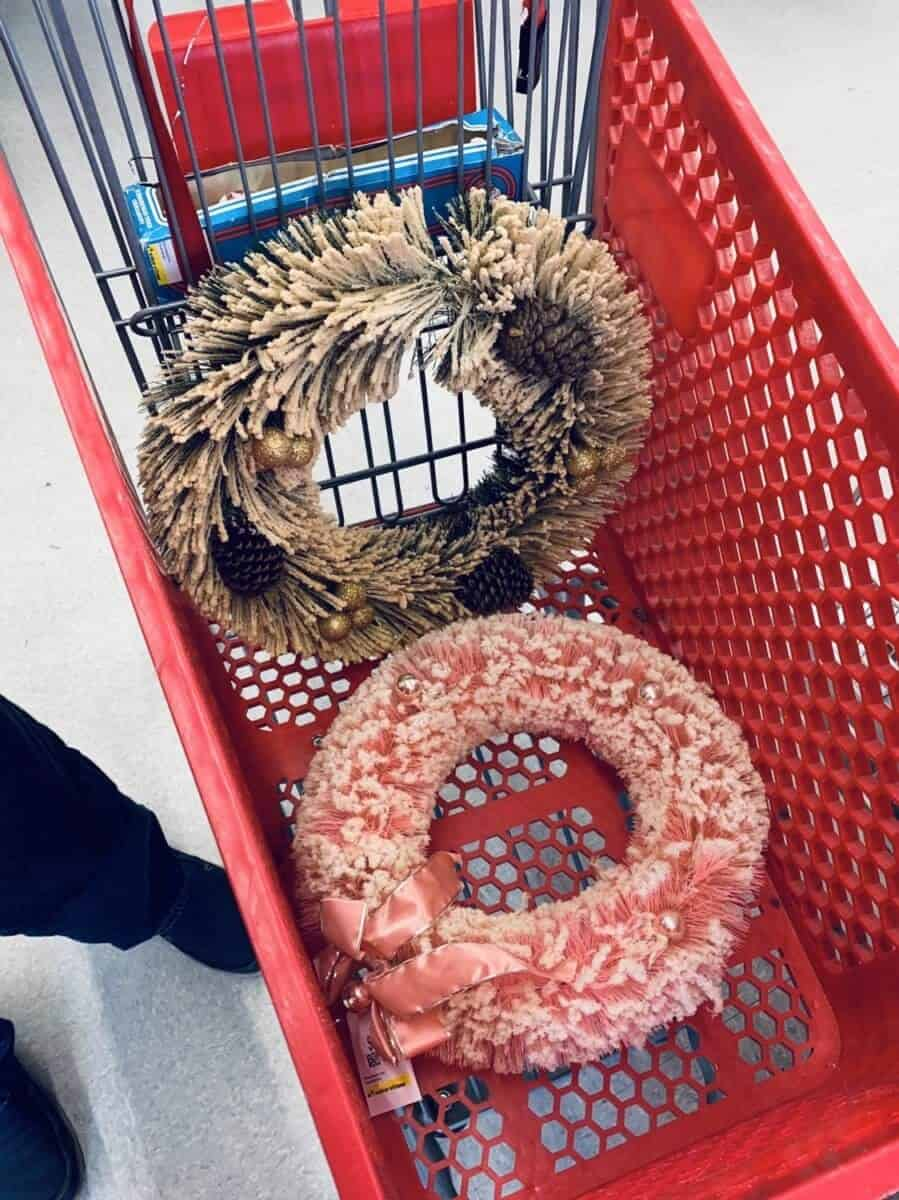 vintage bottle brush wire wreathes flocked with fake snow in a red push cart