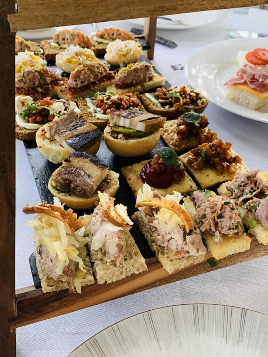 close up delightful savoury little sandwiches and sweet treats