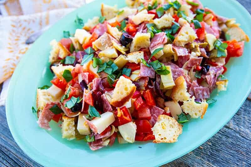 Homemade Antipasto Salad in jade blue plate