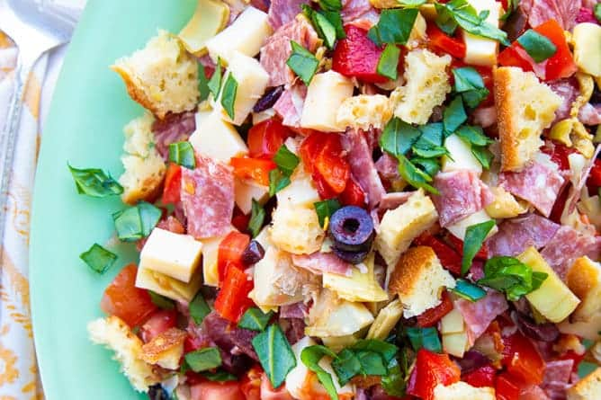 close up Homemade Antipasto Salad in jade blue plate