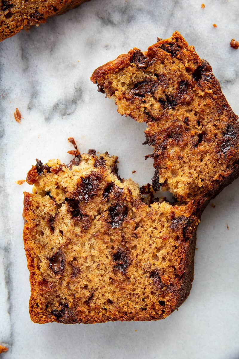 a slice of Chocolate Chip Banana Bread in marble background
