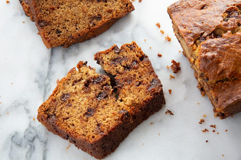 slices of Chocolate Chip Banana Bread in marble background