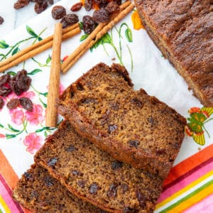 close up Raisins, cinnamon sticks and slices of Cinnamon Raisin Banana Bread