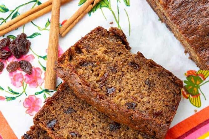 close up Raisins, cinnamon sticks and slices of Cinnamon Raisin Banana Bread