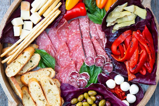 close up Antipasto in a round wooden platter