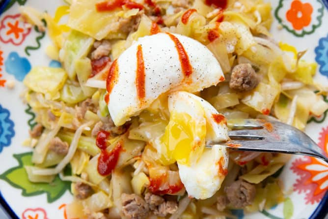 close up Egg Roll in a Bowl with poached egg on top