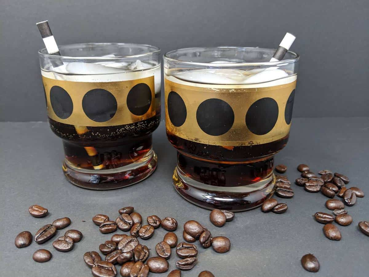 old fashioned glasses with Mind Eraser cocktail, some coffee beans around