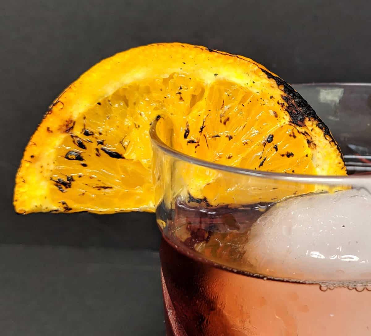 Burnt Orange garnish on a Negroni