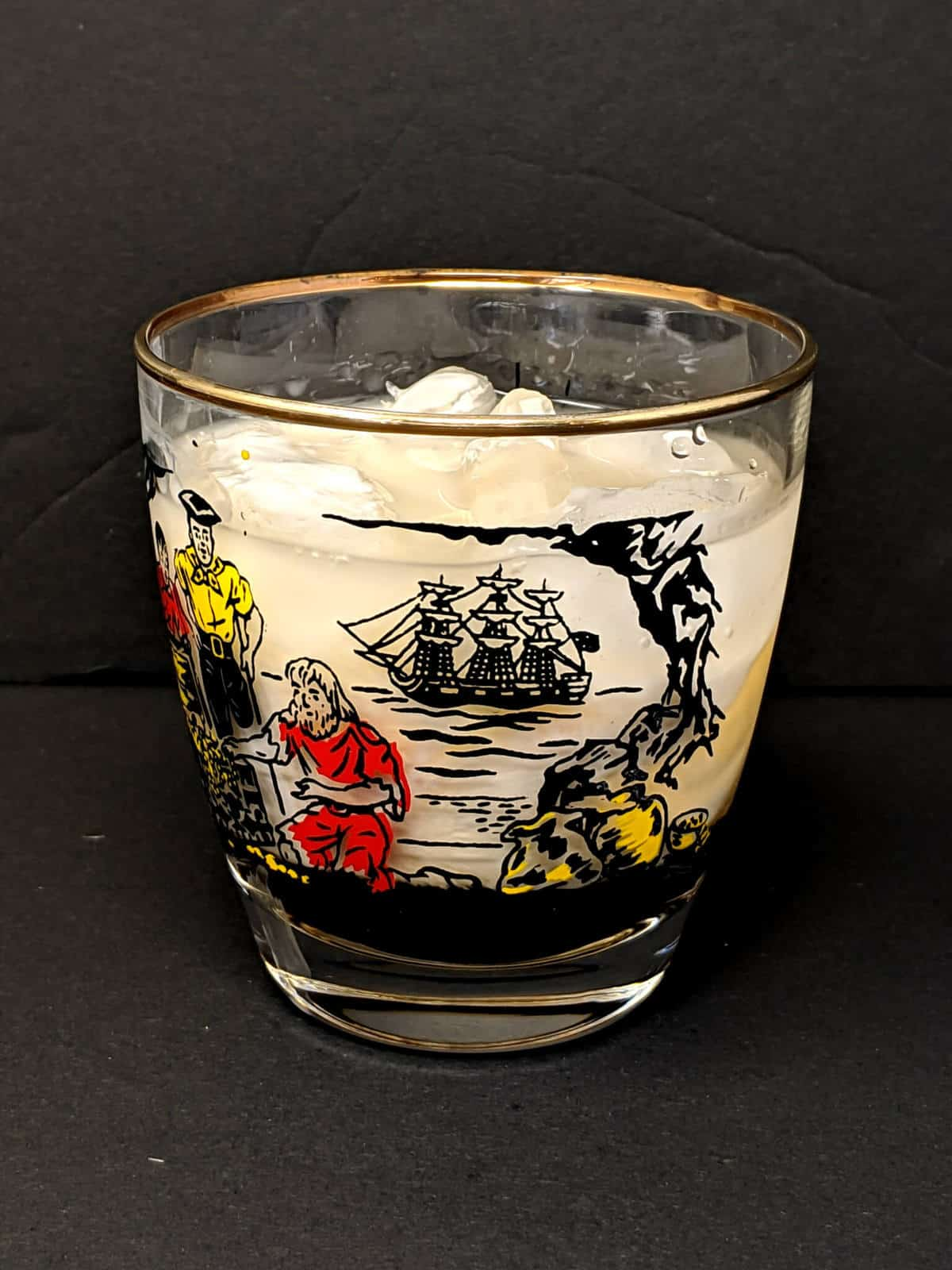 an old fashioned glass with ice and White Russian cocktail