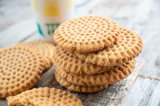 close up stack of Crispy Peanut Butter Cookies in wood background