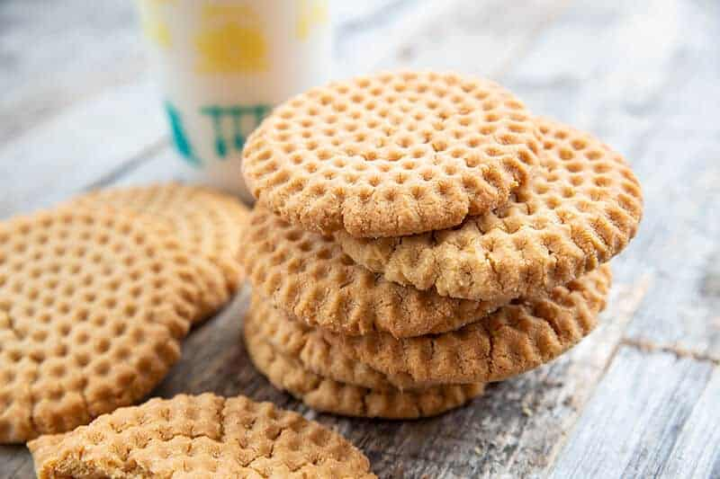 stack of Crispy Peanut Butter Cookies in wood background
