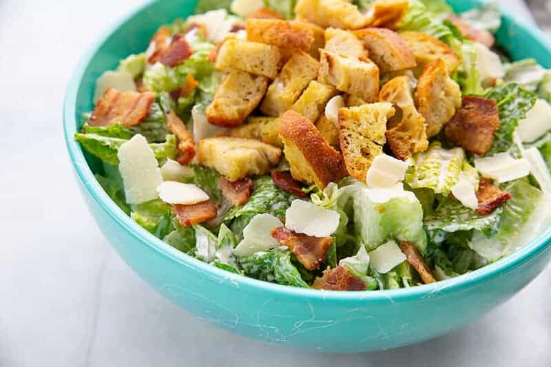 Homemade Classic Caesar Salad in a jade blue bowl