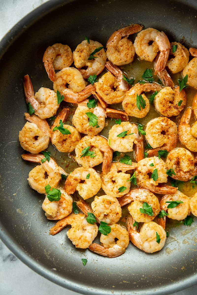 Buttery Old Bay Steamed Shrimp in medium saucepan with melted butter