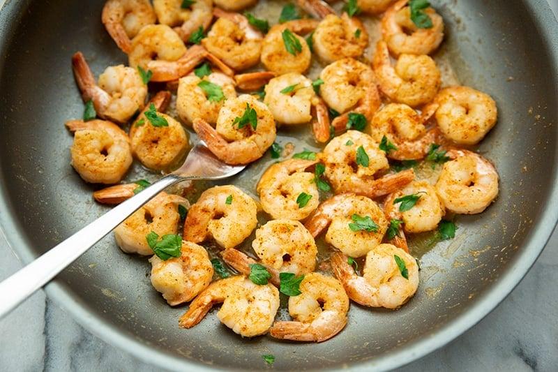 Buttery Old Bay Steamed Shrimp in medium saucepan