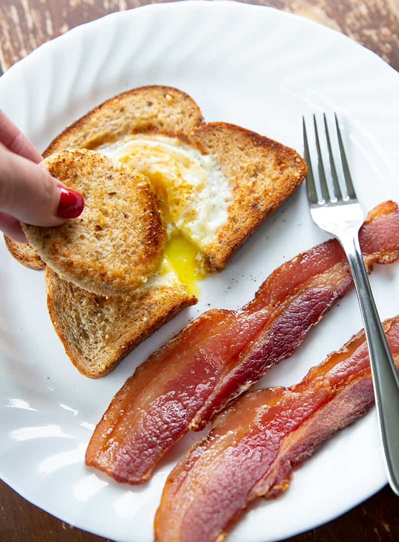 dipping toast into eggs in a basket