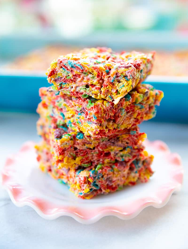 close up stack of sliced Fruity Pebbles Treats in a small dessert plate