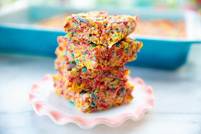 stack of sliced Fruity Pebbles Treats in a small dessert plate