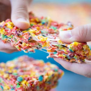 tearing up a slice of Fruity Pebbles Treats