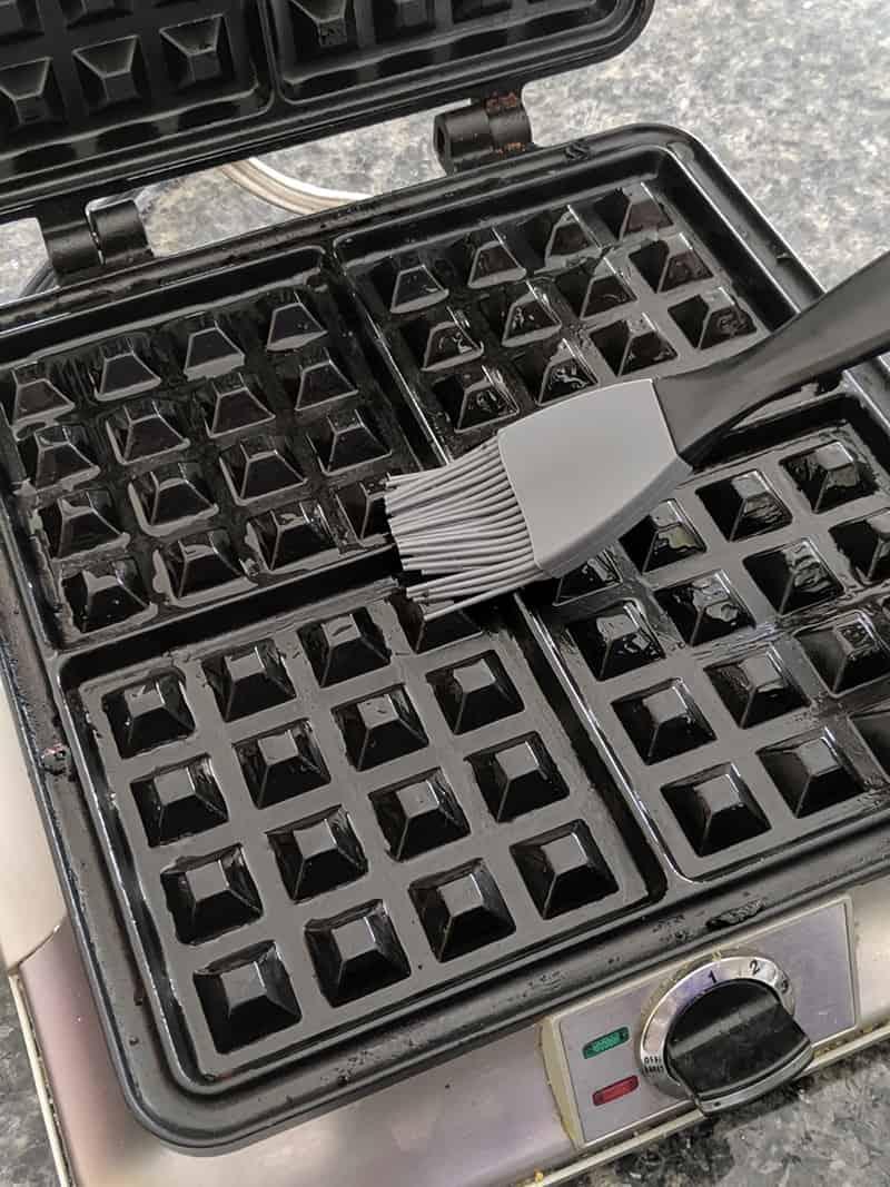 greasing a waffle maker