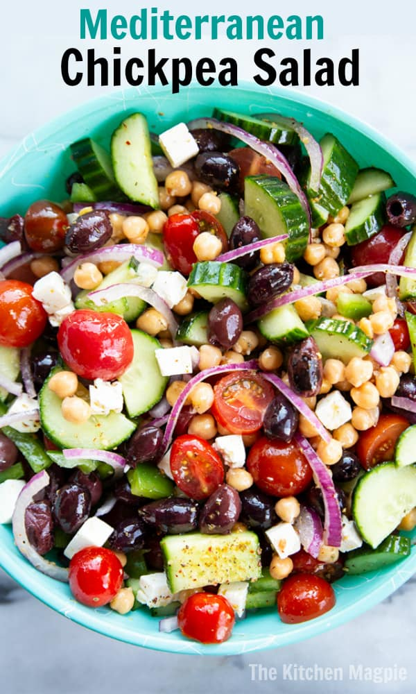 This healthy Mediterranean Chickpea Salad is full of traditional Greek salad flavors, feta, tomatoes, cucumbers, olives and more! #salad #chickpeas