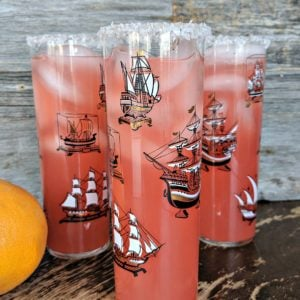 Close up of three Salty Dog cocktails against a wood background