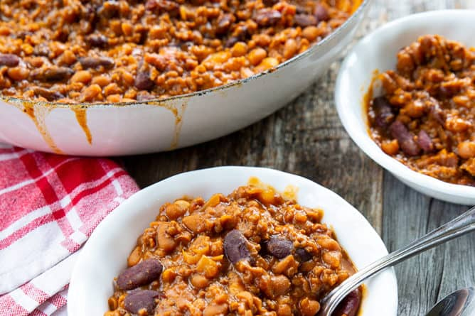 some serving of Cowboy Beans in white small plates