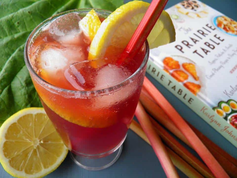 a glass of Strawberry Rhubarb Gin Fizz garnish with a slice of lemon