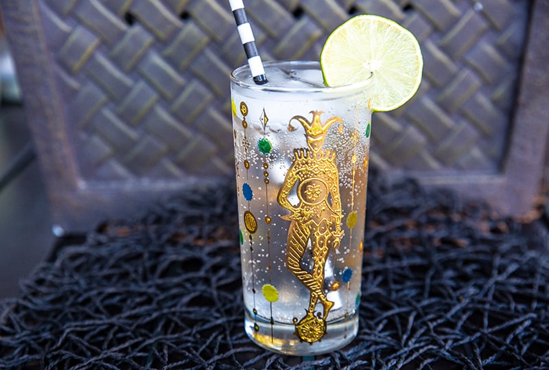 Vodka Soda in a Vintage Mardi Gras Glass garnish with a lime slice
