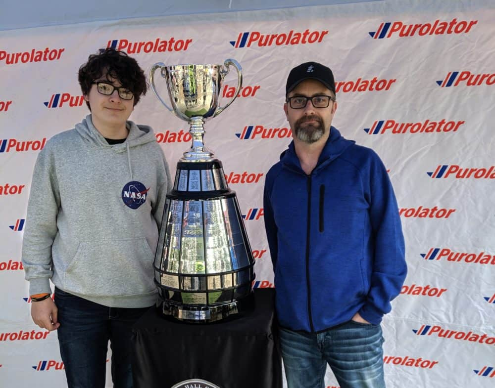 picture with the Grey Cup during PTH game