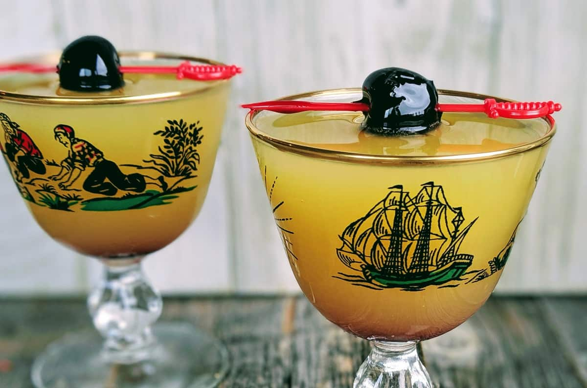 Monkey Gland Cocktail in a Pirate Coupe garnished with a Luxardo Maraschino Cherry