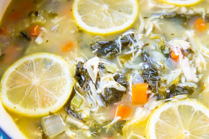 close up Lemon Chicken Soup with Orzo in a large blue pot