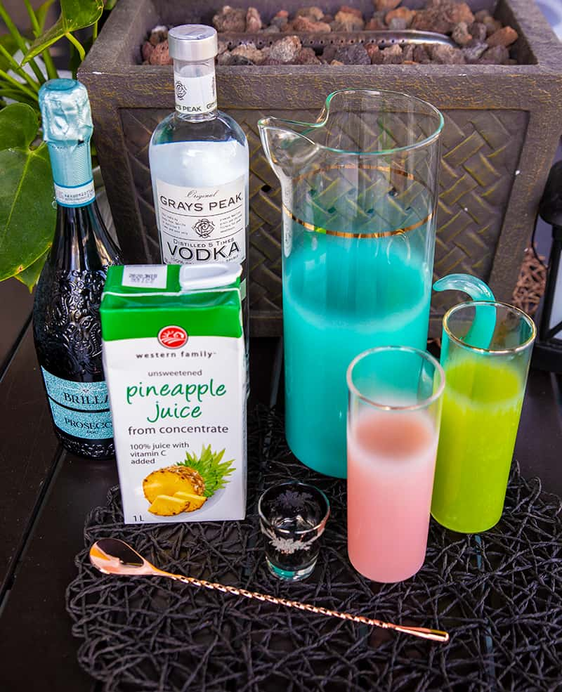 Pineapple Prosecco Punch ingredients - box of Pineapple juice, bottle of Prosecco and vodka