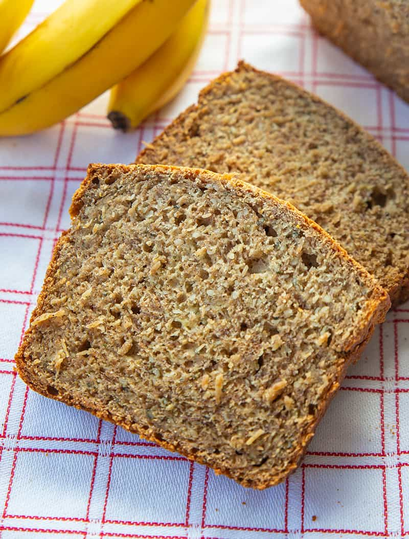 close up healthy banana bread slices, yellow ripe banana on the background