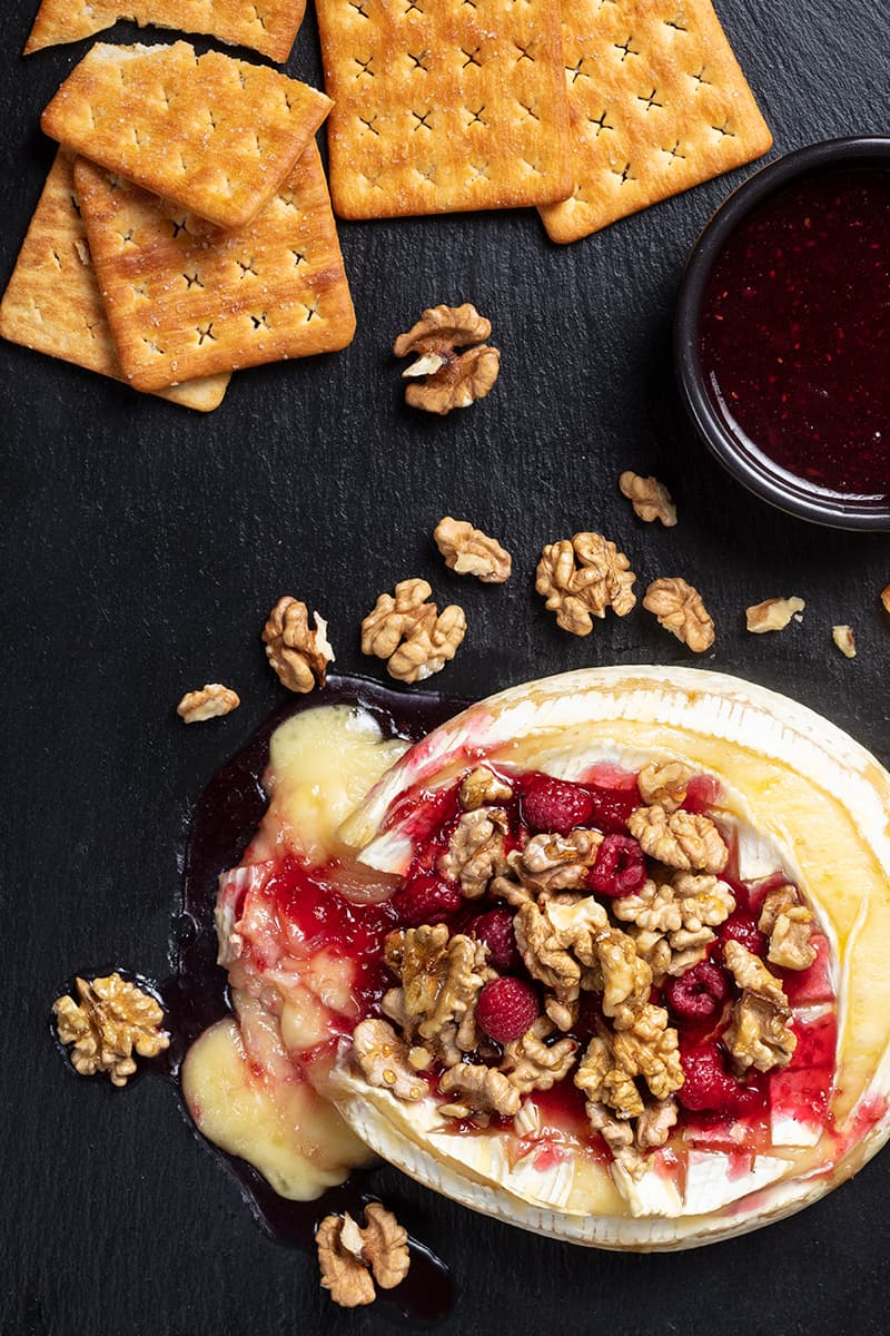Walnut Raspberry Baked Brie with some extra crackers and bread crisps