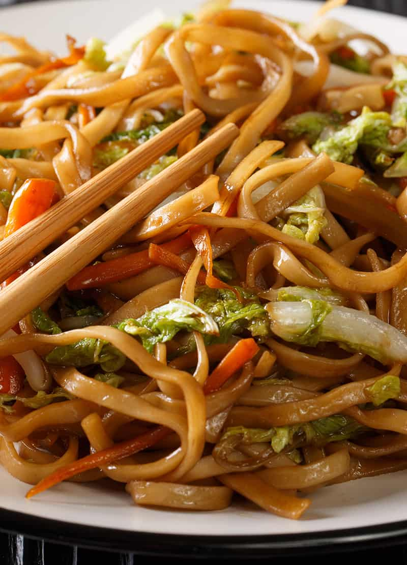 close up of chow mein noodles on white plate - Chow Mein vs Lo Mein