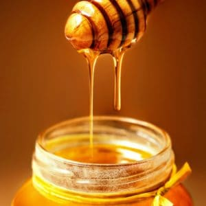 Honey in jar with honey dipper.