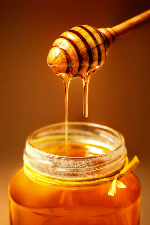 Honey in jar with honey dipper