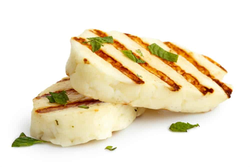 Grilled slabs of Halloumi Cheese on white background