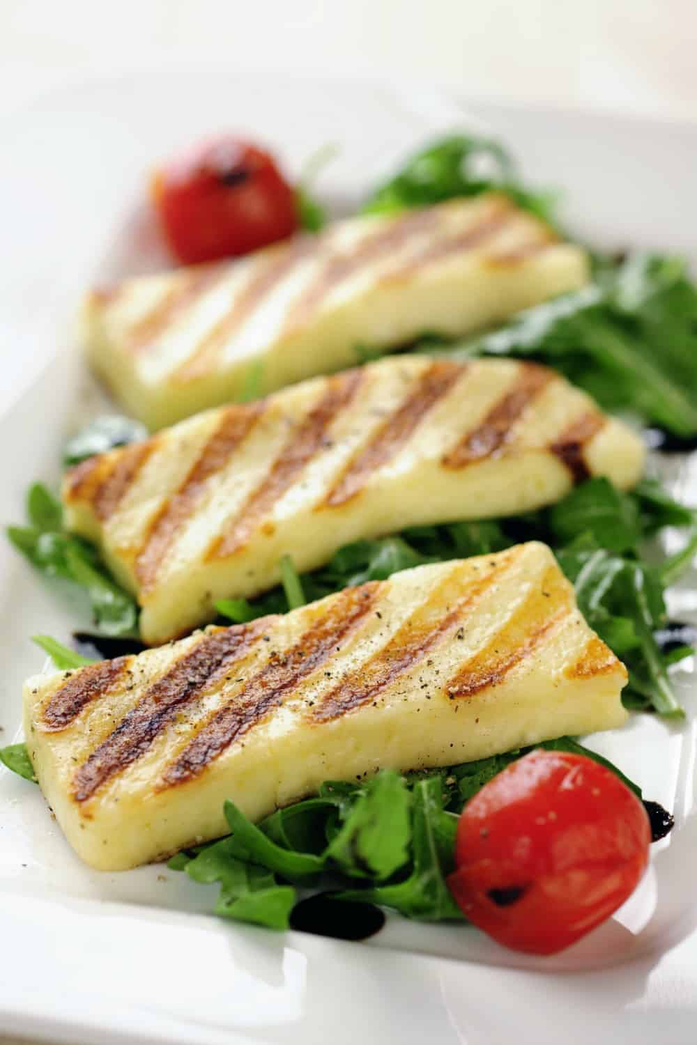 close up Grilled slabs of Halloumi cheese on salad