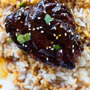 close up Instant Pot Chicken Thighs on rice with Honey Garlic sauce
