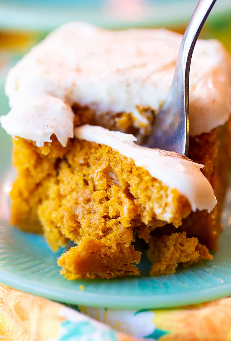 using a fork to get a piece of Pumpkin Bar with Cream Cheese Frosting