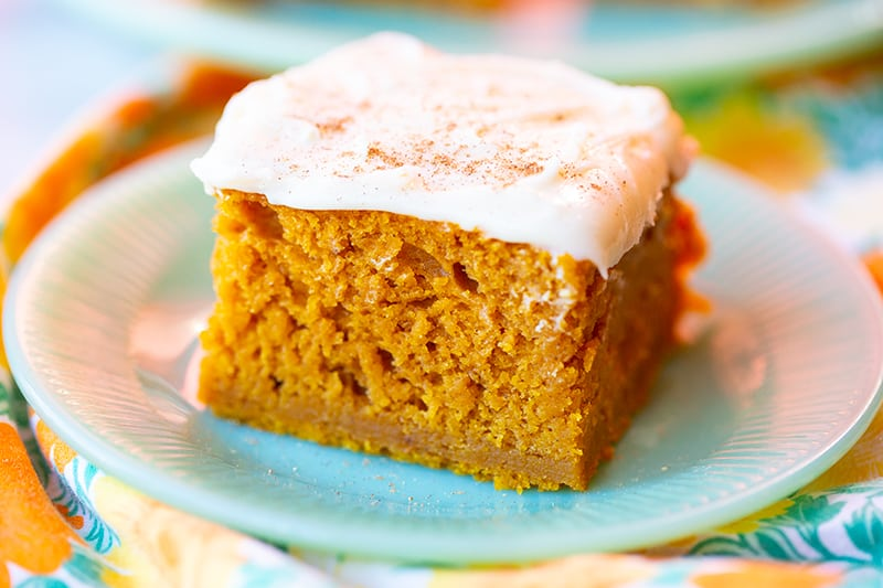 Pumpkin Bar with Cream Cheese Frosting in a white dessert plate