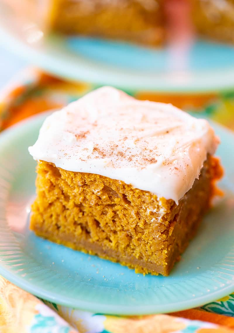close up Pumpkin Bar with Cream Cheese Frosting in a white dessert plate