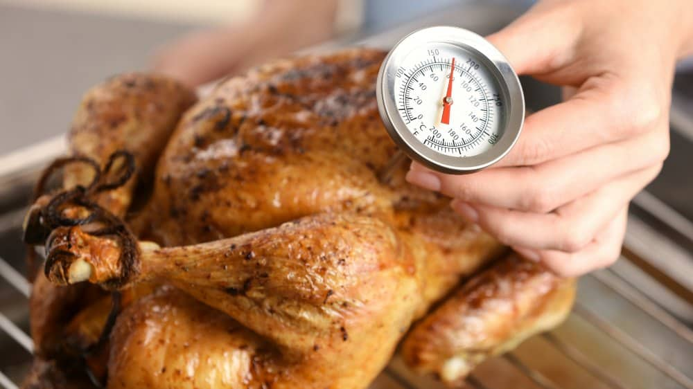 using a meat thermometer in working with roasted chicken temperature