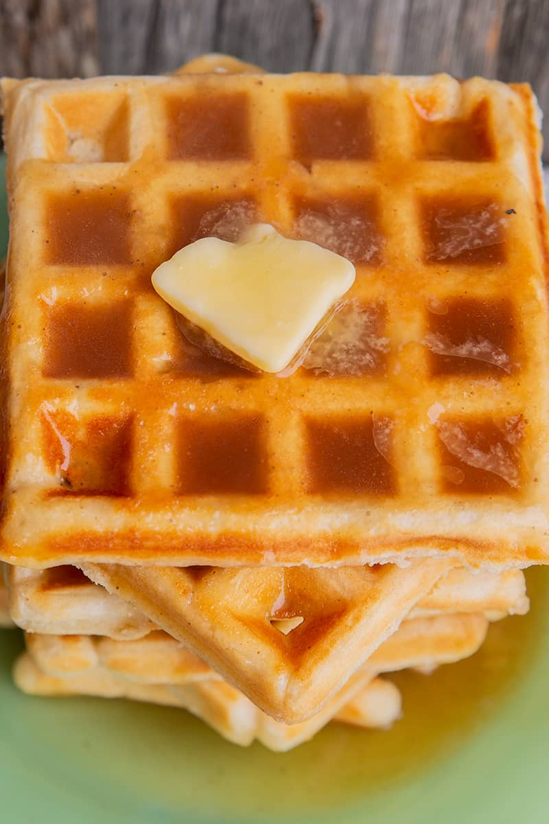 close up stack of waffle with Brown sugar syrup and butter